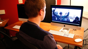 "Student Alec Brown reviewing his film ""I'm Not Here"" in the Film School labs"