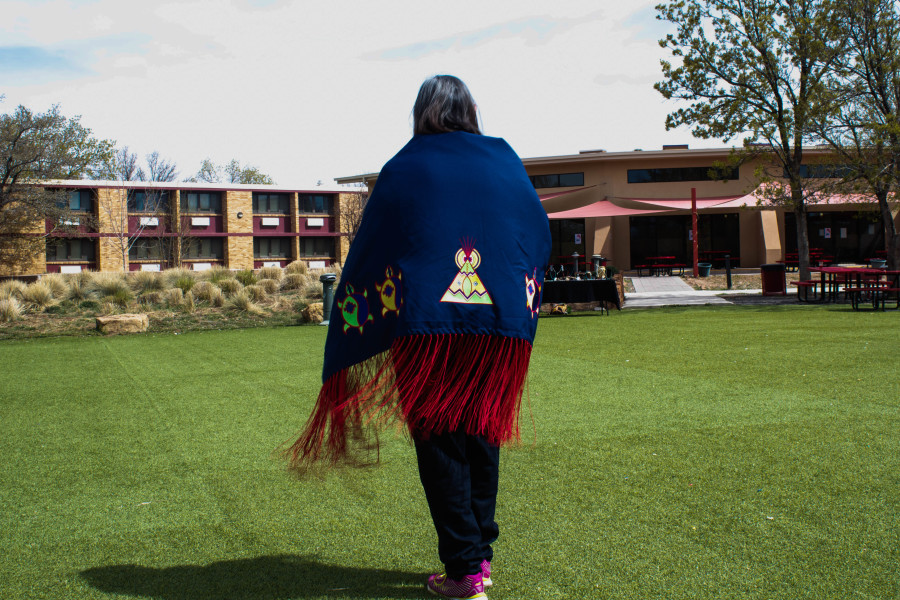 Pacheo's Drum Group member Irene Edwards dances the traditional Circle Dance on the Quad. Photo by Charlotte Martinez