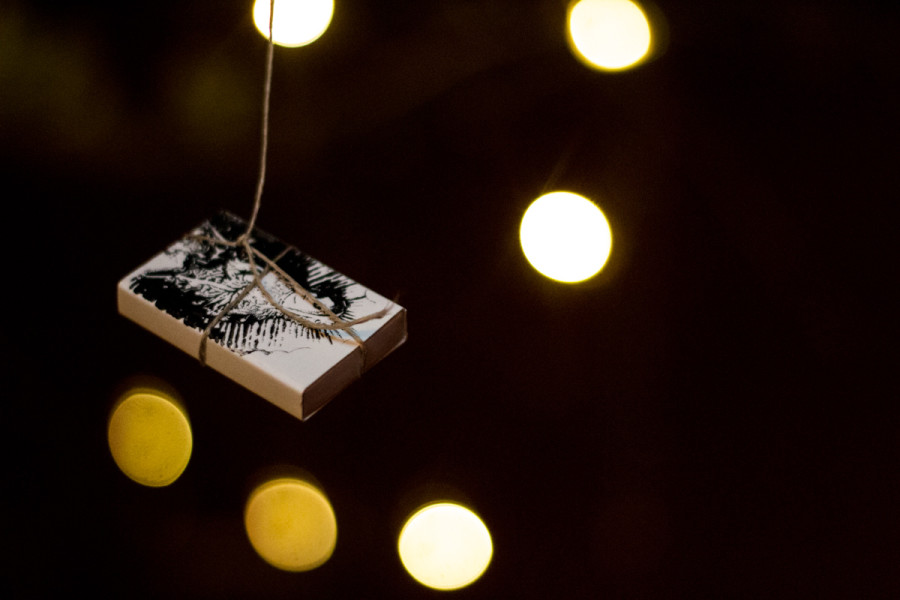 The Creative Writing Department prepares poems inside matchboxes hanging from a tree for OVF.