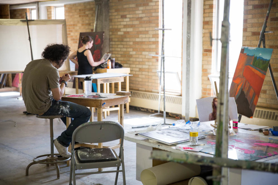 Studio Arts students Juan Rivera and Hannah Gardner take advantage of the abundant natural light in the studio.  Photo by Jessie Leigh