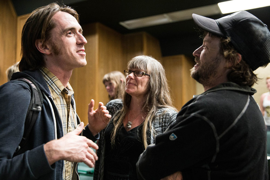 Left, Ben Wright, Sound Team leader for Meow Wolf project House of Eternal Return, speaks with volunteers.  Photo by Jessie Leigh
