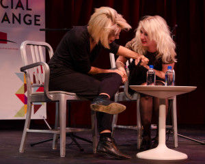 Nadya and Masha arm wrestle in response to questioning. Photo by Ashley Costello