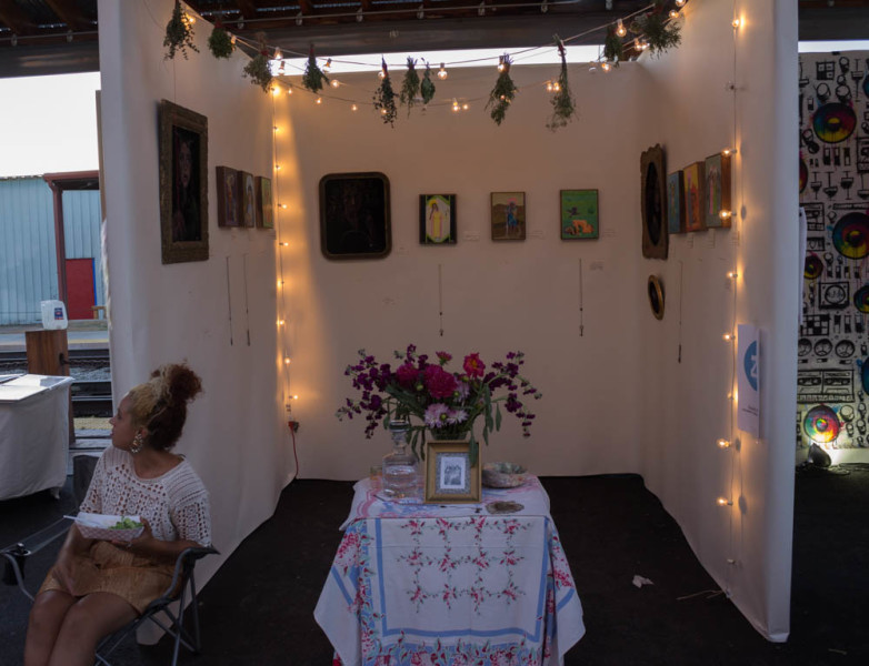 Local artists showed their work in little cubicles at AHA Fest. Photo by Kyleigh Carter.