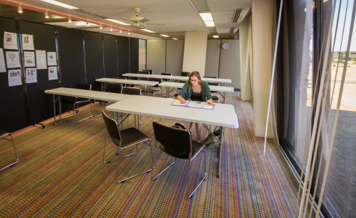 Student Sara Traband, using the newly added classrooms, In the graphic design department, photo by Jason Stilgebouer.