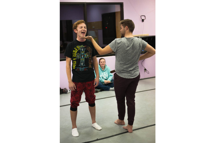 A student receives direction in preparation for the New Student Show. Photo by Forrest Soper.