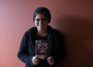 Creative Writing student Jen Hanson with one of her favorite films, Shaun of The Dead. Photo by Kyleigh Carter.