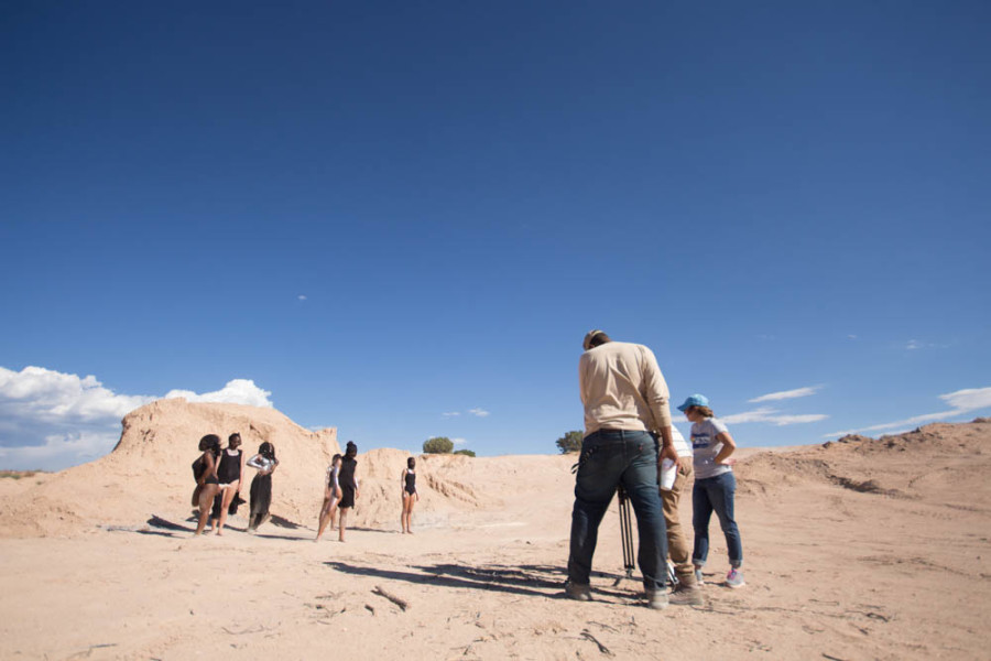 The crew filming the desert dancers in the music video. Photo by Jason Stilgebouer.
