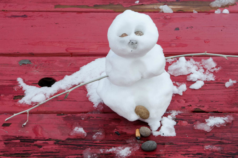 The snowman has already began to melt in the sunlight. Photo by Forrest Soper.