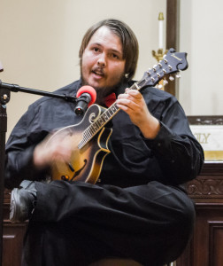 John Church playing mandolin and singing. Photo by Christy Marshall