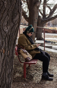 Abdiel Beltran sits out side St. Michael's hall waiting for lunch. Photo by Christina Marshall