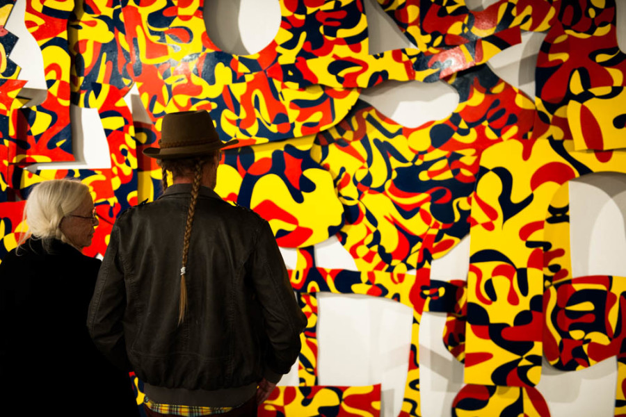 "Gallery patrons view Kevin Bouton-Scott's piece ""Attending Art School with Phat Le."" Photo  by Forrest Soper."