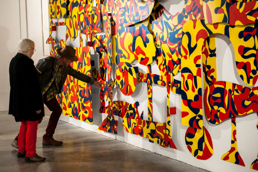 """Gallery patrons view Kevin Bouton-Scott's piece """"Attending Art School with Phat Le."""" Photo  by Forrest Soper."""