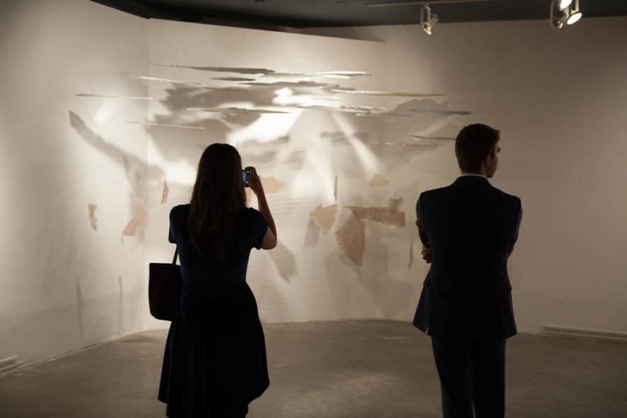Elizabeth Leonard photographs her installation piece. Photography by Forrest Soper.