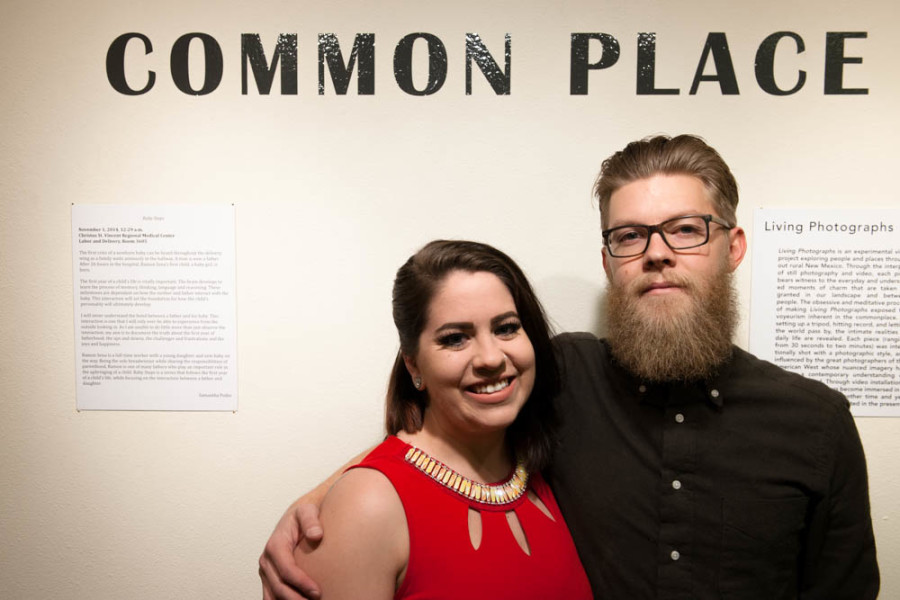 "Samantha Podio and Brad Trone stand beside their artist statements at the opening for ""Common Place"" on Dec. 11. Photo by Forrest Soper"