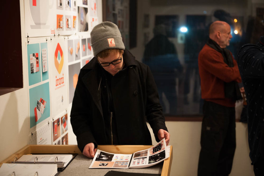 A gallery patron views a portfolio of student work at Critical Space on Dec. 14. Photo by Forrest Soper.