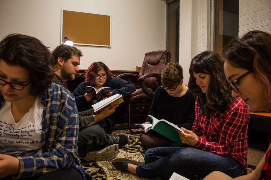 2016 Glyph editorial staff read past issues of Glyph. From left to right: Melinda Freudenberger, Andrew Koss, Amaya Hoke, Brianna Neumann, Anne Valente and Marisa Doherty. Photo by Christy Marshall