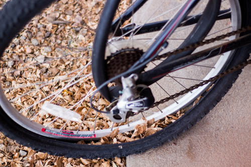 A broken bike sits with an inner tube busted out of the tire. Photo by Jason Stilgebouer