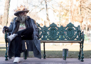 Santa Fe local known as Doc, sits at his bench enjoying his day. Photo by Jason Stilgebouer