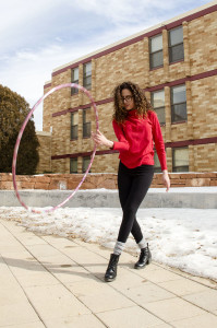 Brenda Castro hooping outside of her dorm hall on January 25. She learned two years ago from a friend in Mexico , and practices in her spare time between classes.