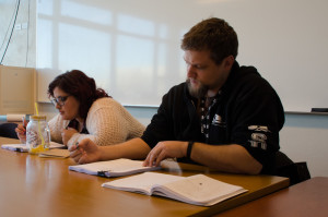 Editors Andrew Koss and Amaya Garza examine the Glyph manuscript. Photo by Rebeca Gonzalez