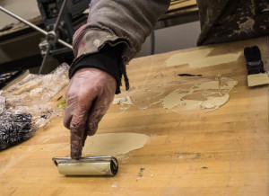 Conor Flynn gets his brayer ready to ink. Photo by Christy Marshall