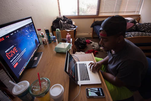 "La' Charles Trask prepares to watch his favorite show ""Scandal"" on Netflix. Photo by Jason Stilgebouer."