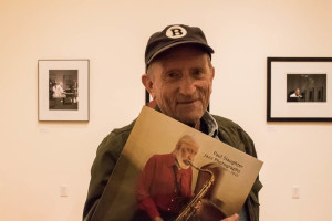 "Baron Wolman , the first editor of photography for Rolling Stone and a patron of the ""Jazz Greats"" opening, shows his enthusiasm for Paul Slaughter's work. Photo by Christy Marshall"