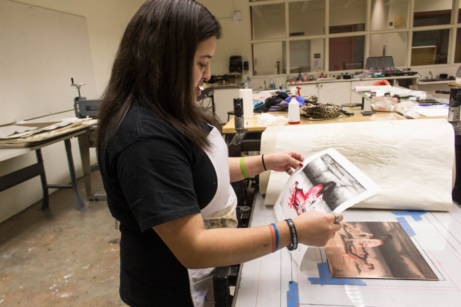 Sen Salinas, a Studio Arts major, spends times in the printmaking studio late at night. Photo by Marco Rivera