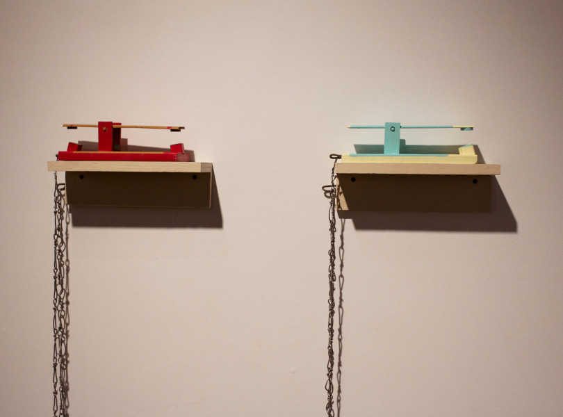 "Sculpture by Garret Koch ""Childs Toys"". Made with wood, acrylic paint, magnets and solder. Photo by Whitney Wernick"