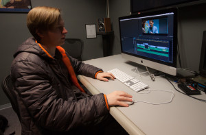 Junior Film major Alec Brown works on post production for the film Karkutong. Photo by Jason Stilgebouer.