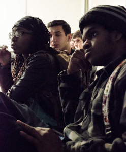 Thulani Mason, Chassity Coleman, Robert Canales, and Daniel Omar listen to the cause and effect of racism. Photo by Rebeca Gonzalez
