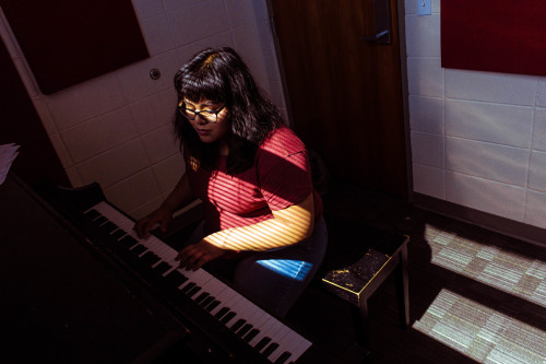 Jazmin Ramirez, a Film Production major with a focus on cinematography, practices playing the piano after class.