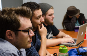 Seniors Riley Gardern and DeAndre Montoya listen to Terry Borst for advice on screenplay editing. Photo by Rebeca Gonzalez