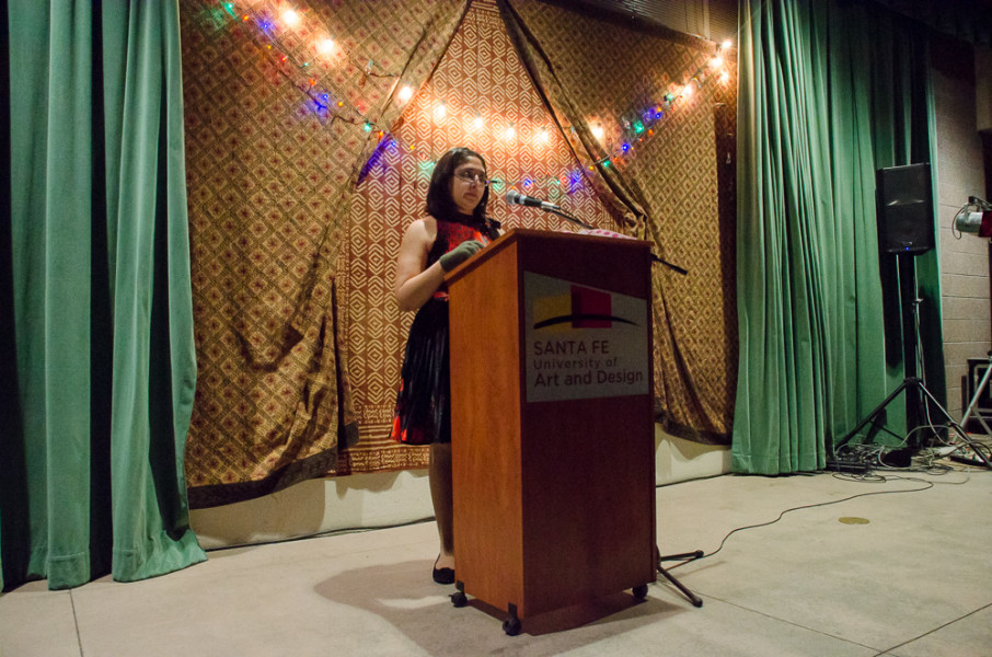 Rosario Neria reads her poetry at the first round of senior readings. Photo by Rebeca Gonzalez