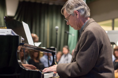 New Mexico School for the Arts teacher Burt Dalton plays the piano. Photo by Jason Stilgebouer.