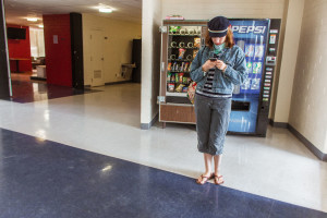 Mariah checks her phone  in the King building's  lobby before heading to class. Photo by Marco Rivera