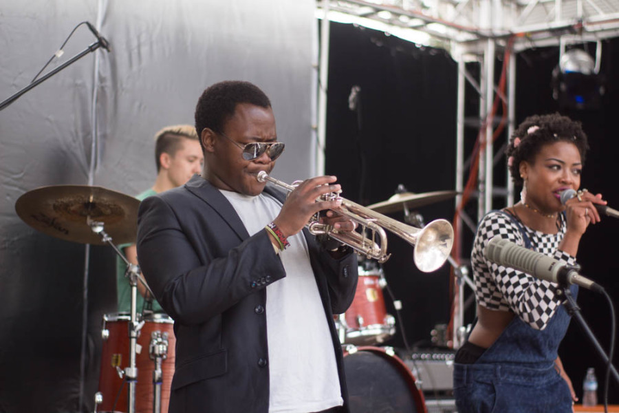 Ardaya's trumpet player Njaveva Bingana performs along side band members at Quadstock. Photo by Jason Stilgebouer.