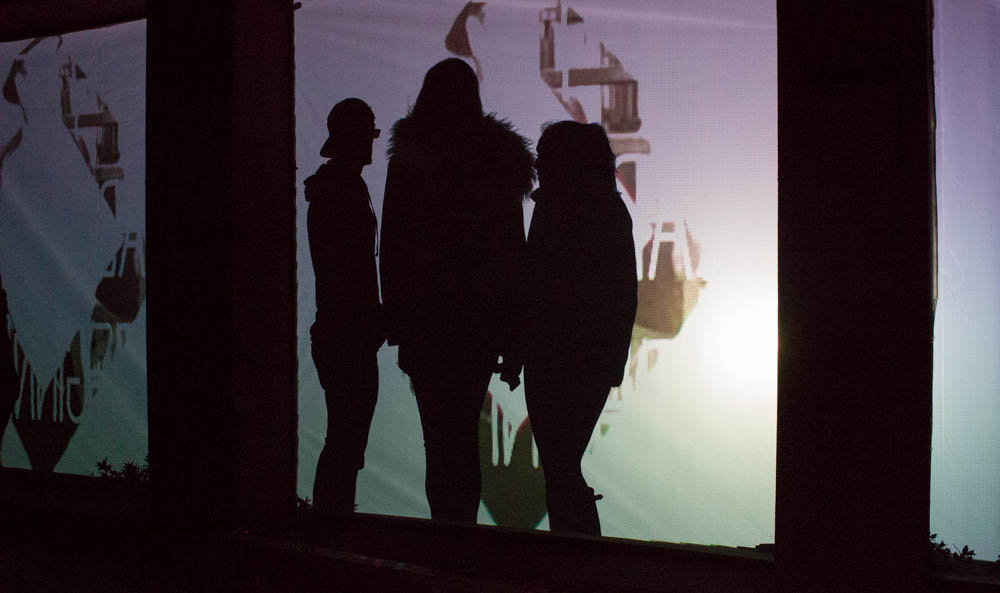 A group of students plays around with one of the many interactive light shows at OVF. Photo by Kyleigh Carter.
