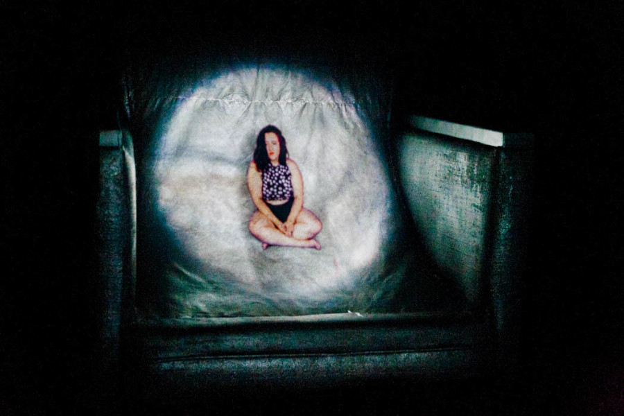 Small figure projected onto a chair with audio at OVF 2016. Photo by Whitney Wernick.