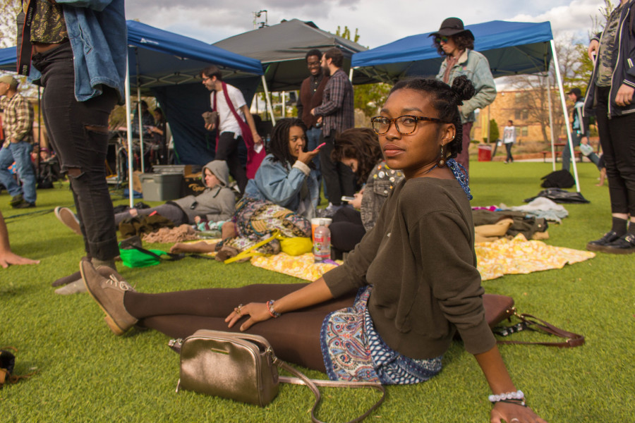 Valencia Lusk enjoys the band performing at Quadstock. Photograph by Marco Rivera