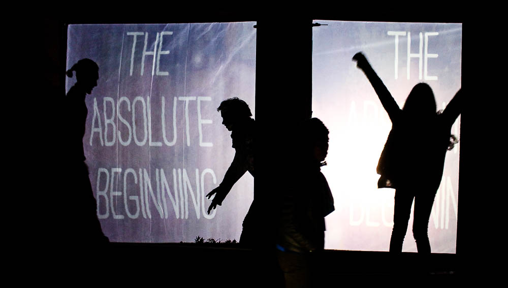 Students have fun with using the projections and their shadows. Photo by Christy Marshall