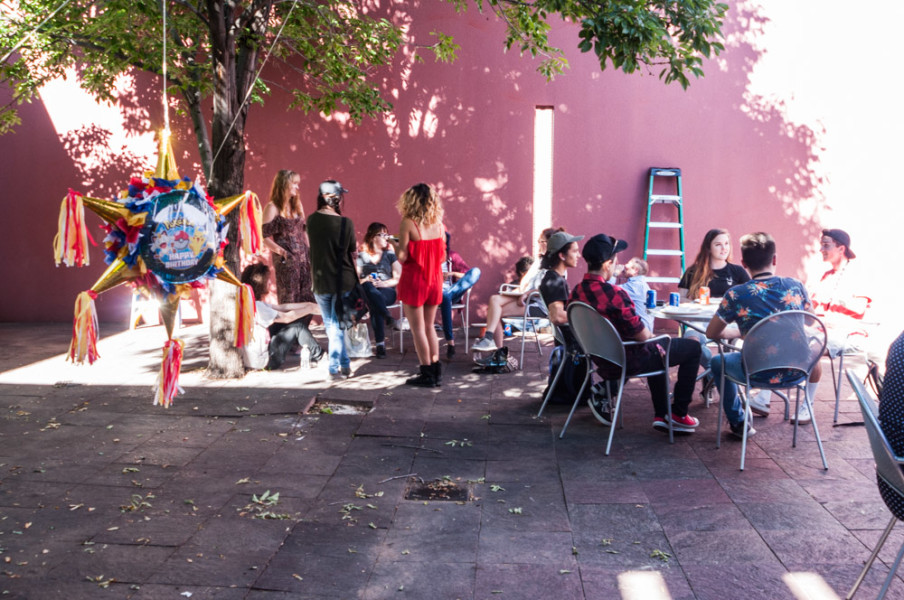 Photography students gathering in the Marion Center courtyard for the department barbecue. Photo by Sasha Hill