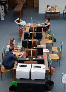 students using the computer lab in Folgelson Library. Photo by Sasha Hill
