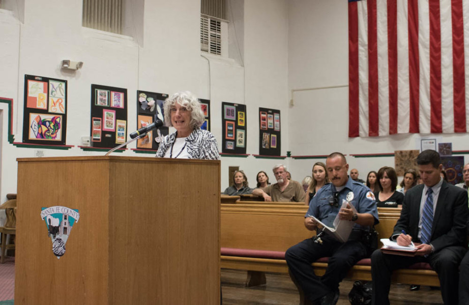 Linda Kastner, one of 500 citizens who signed the Chain Free petition, addresses the Santa Fe County Commissioners on Sept.13. Photo by Chris Dorantes