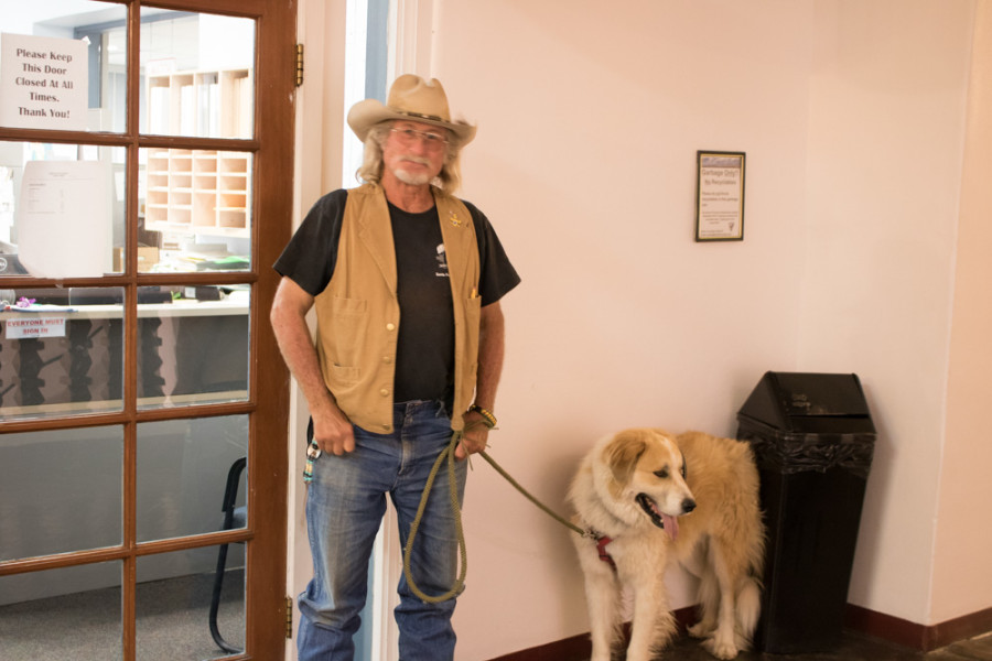 Gus Jolly and his therapy dog Otie attend the Chain Free Santa Fe hearing at the Board of County Commissioners in Santa Fe on Sept. 13. Photo by Chris Dorantes