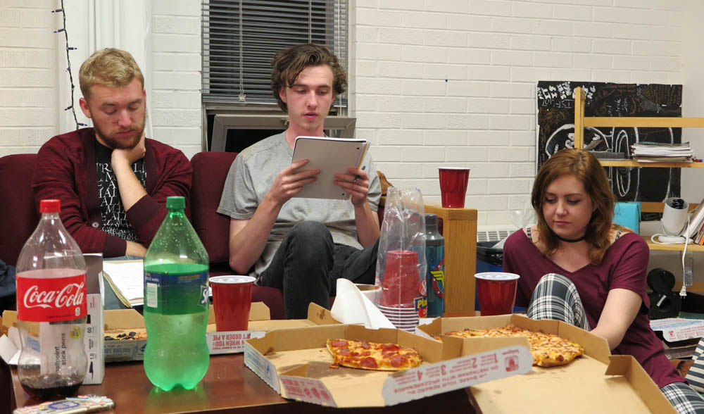 Duncan Calem and Kylie Yockey listen as Isaac Leigh reads his short story. Photo by Marisa Doherty.