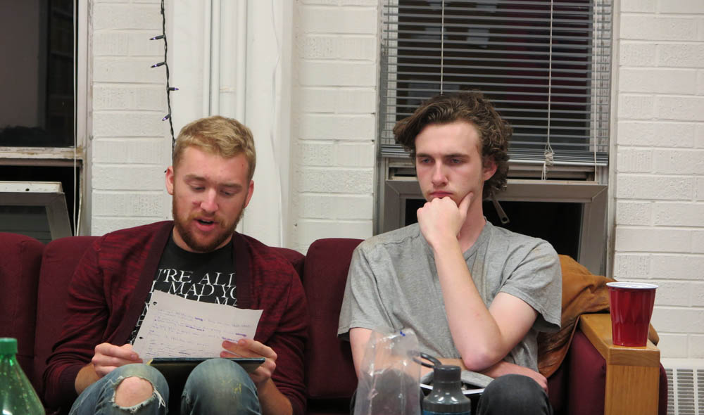 Isaac Leigh listens as Duncan Calem reads his piece aloud. Photo by Marisa Doherty.