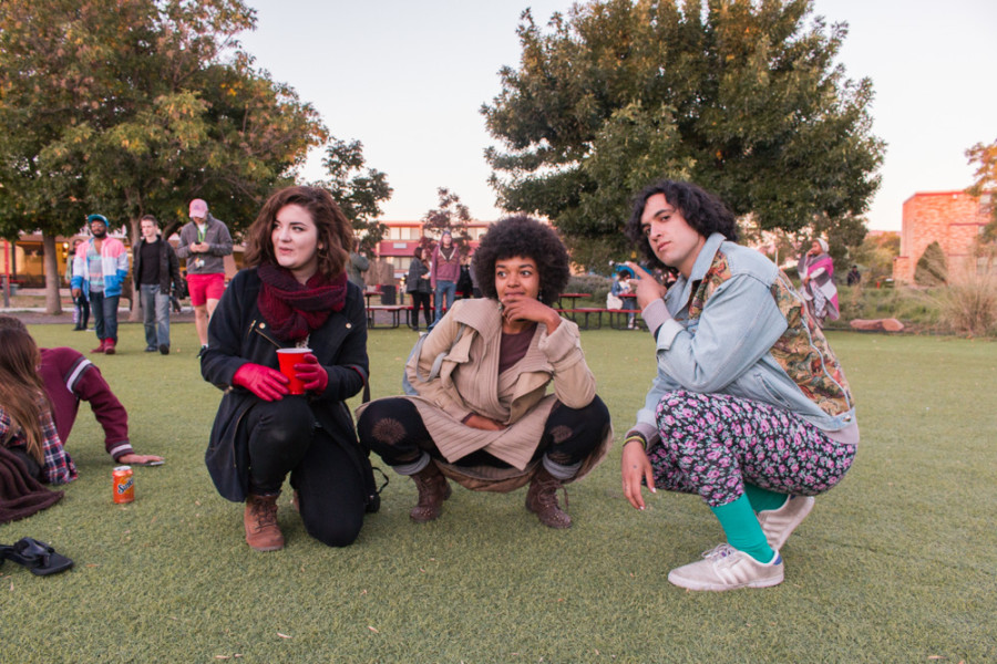 Students of Santa Fe University of Art and Design Melissa Schoonfield, Tawanda Suessbrich, and Kagan Marks eagerly await for the next band to take the stage at the City Different Festival. Photo by Yoana Medrano.
