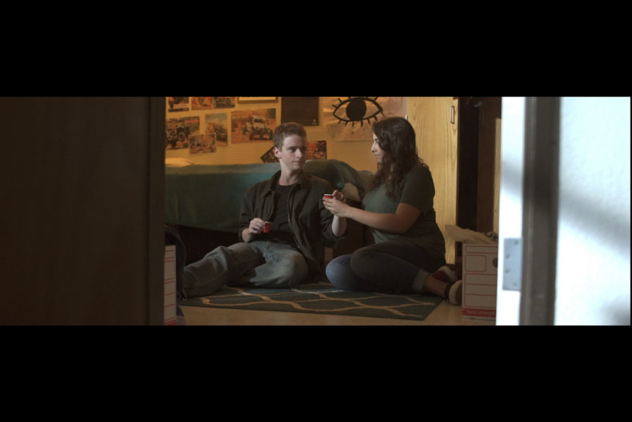 "Screenshot from Osman Tahirbeyoglu's ""Trip to Hell,"" featuring Tom Johnson's cinematography, Dylan Salewski (left) as ""Mason,"" and Rebecca Spector (right) as ""Maria."""