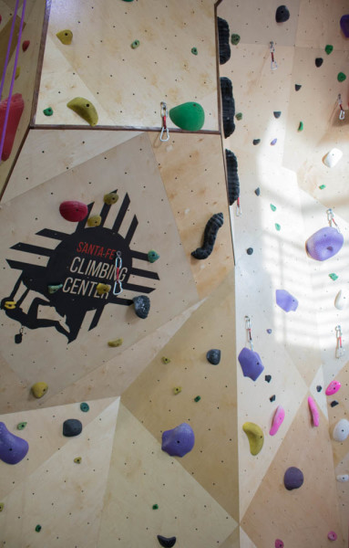Logo of Climbing Center plastered in the middle of routes. Photo by Kaitlyn Sims.